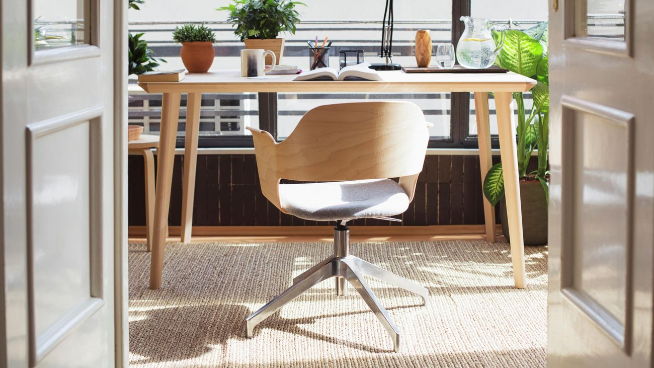 Wooden desk and chair in sunny window