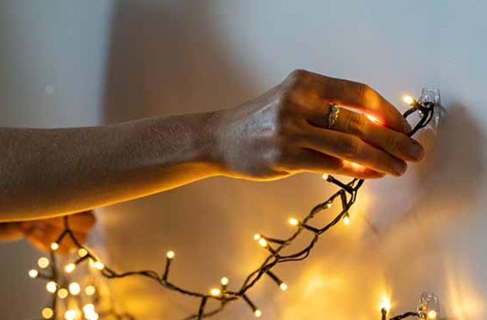 Attaching fairy lights to a wall