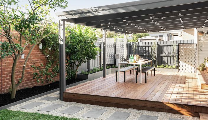 Backyard with decking, outdoor setting and pergola.