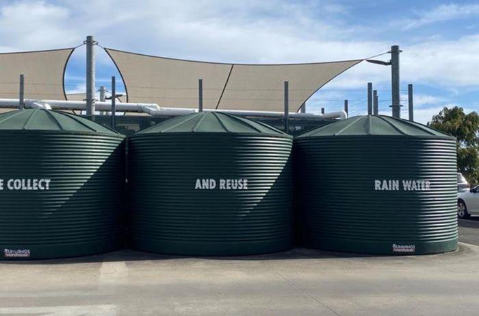 three rain tanks on exterior of warehouse