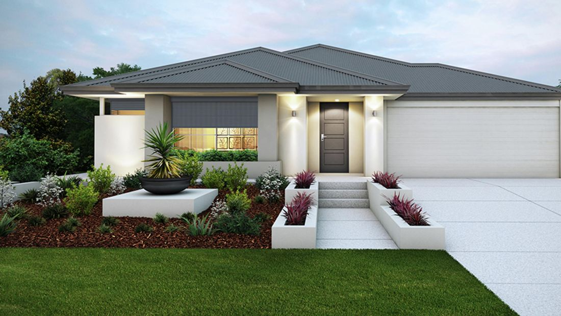 House exterior with lights, garden area, driveway and garage.