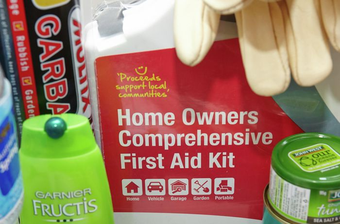A first aid kit, garbage bags, canned tuna and shampoo bottle