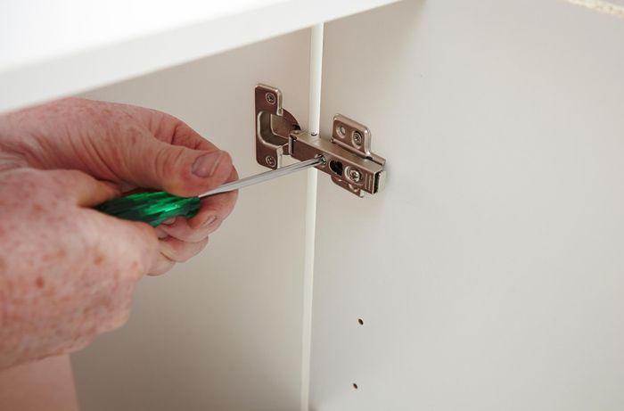 DIY Step Image - How to install cabinet hinges . Blob storage upload.