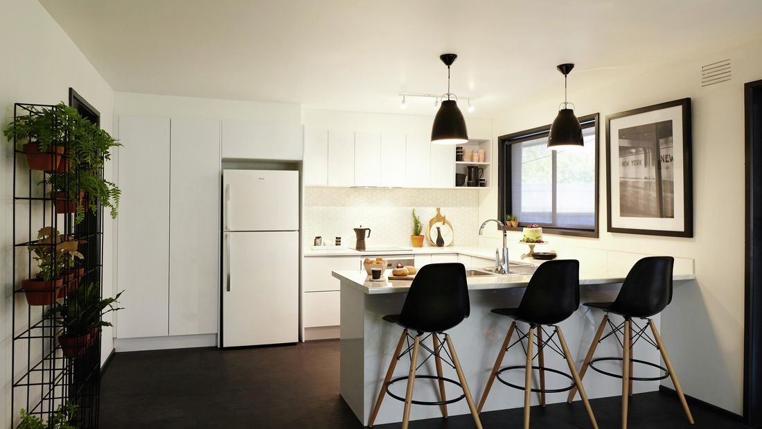 Renovated kitchen featuring a lot of white.