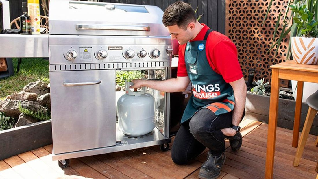 Bunnings team member changing a gas bottle in a BBQ