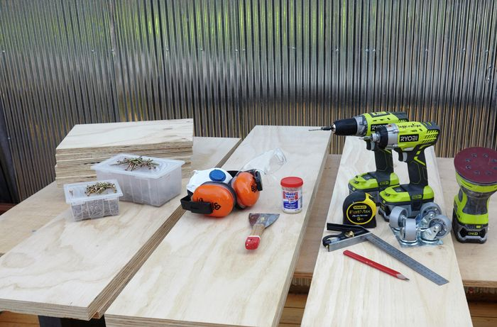 The tools and materials for this job, including power drills, power sander, lengths of timber, screws, a square rule, a paint stripper, putty, protective gear and more