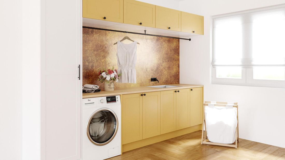 close up image with timber flooring, washing machine, overhead cupboards and washing hamper and white timber window