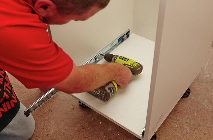 DIY Step Image - How to install push-to-open drawer runners . Blob storage upload.