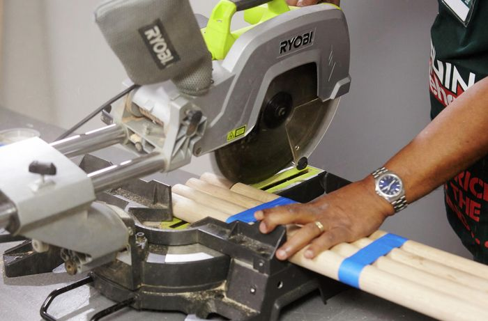 Bar stool legs being cut with a mitre saw