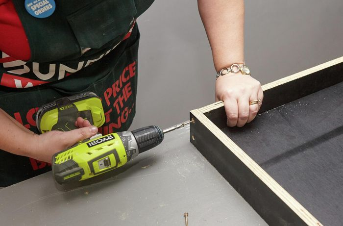 Person drilling form ply frame side together.