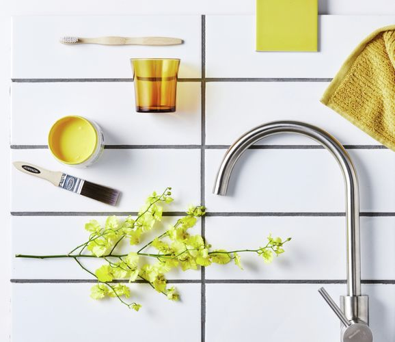 tap, towel and brush on tiles