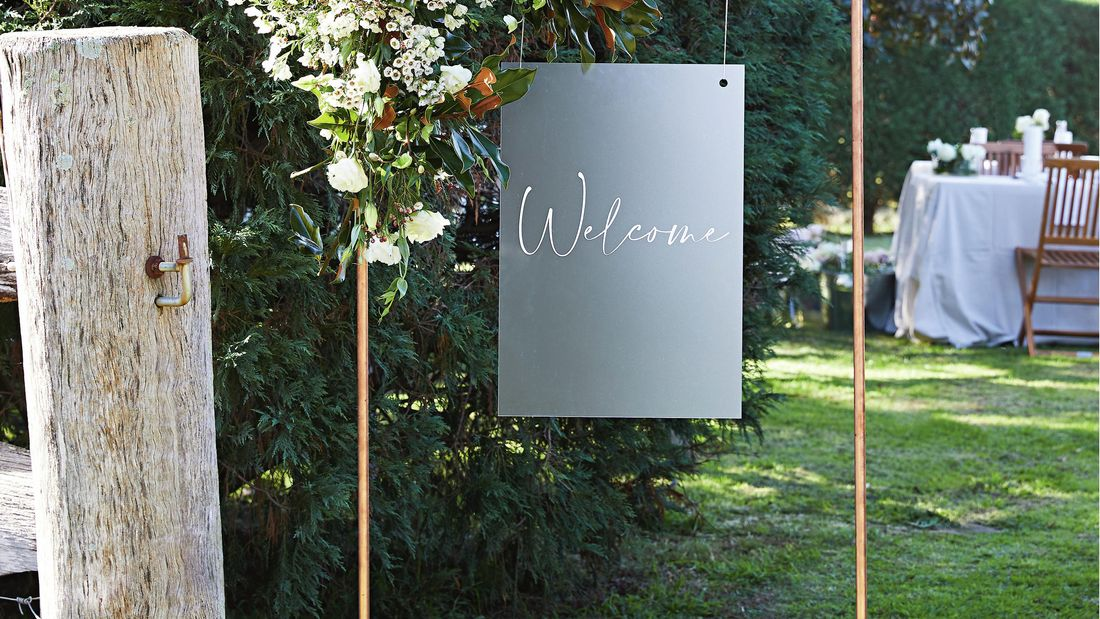 A creative D.I.Y. copper frame, hung with a lightweight sign that reads 'Welcome'.