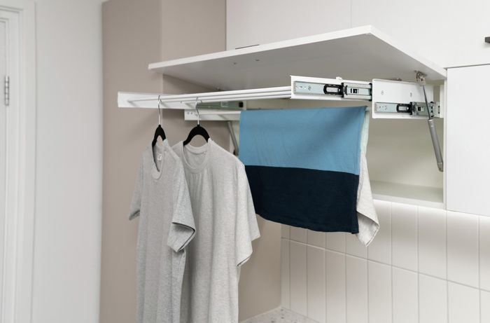 Cabinet with drying rack for clothes.