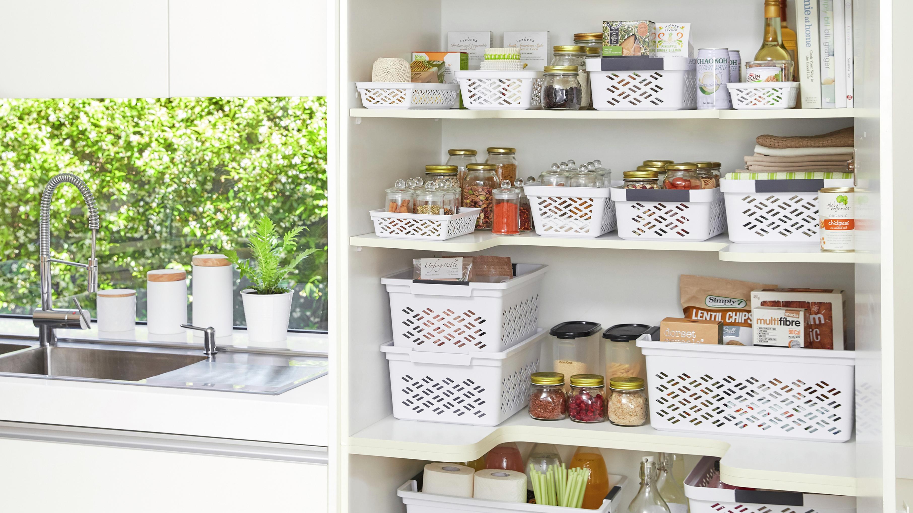 Kitchen pantry with storage baskets.