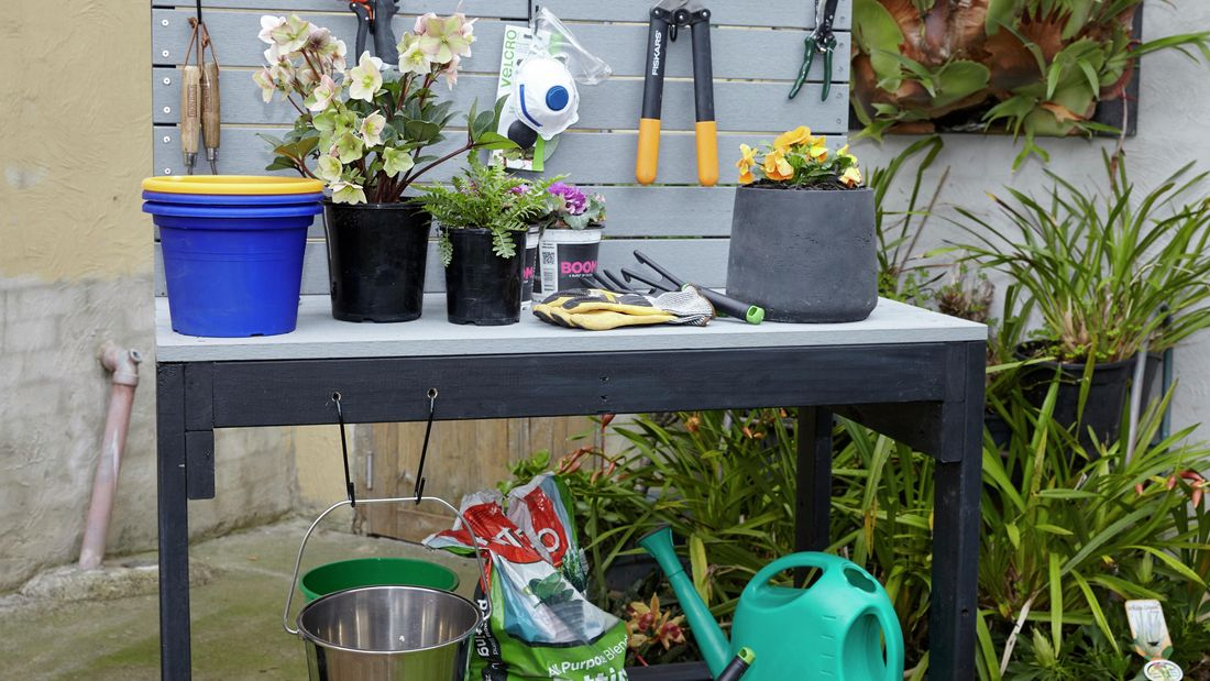 Potting bench in a garden setting.