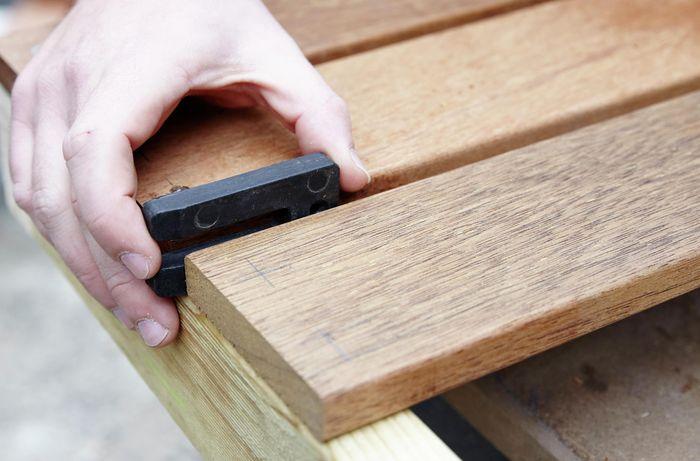 Person spacing timber apart.