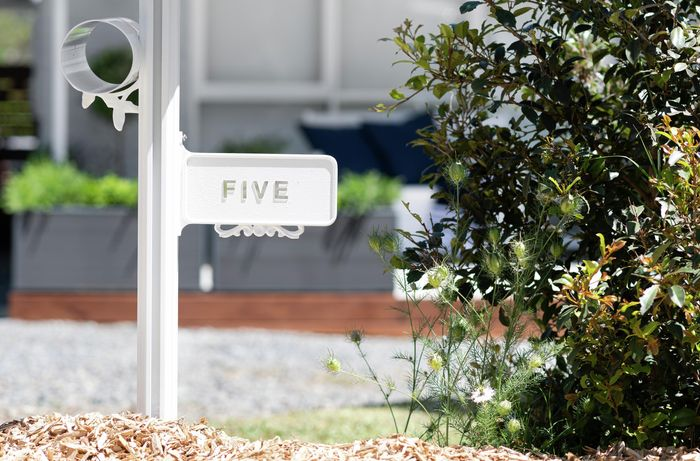 A finished letterbox with the number five