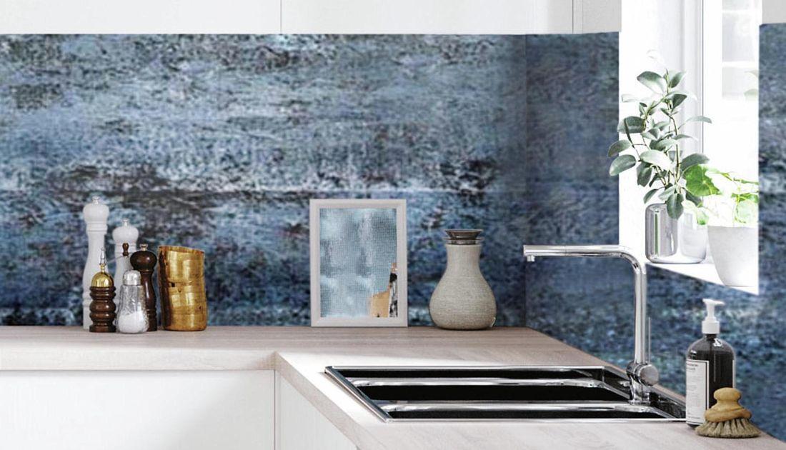 Scandi-style minimal kitchen featuring a blue splashback