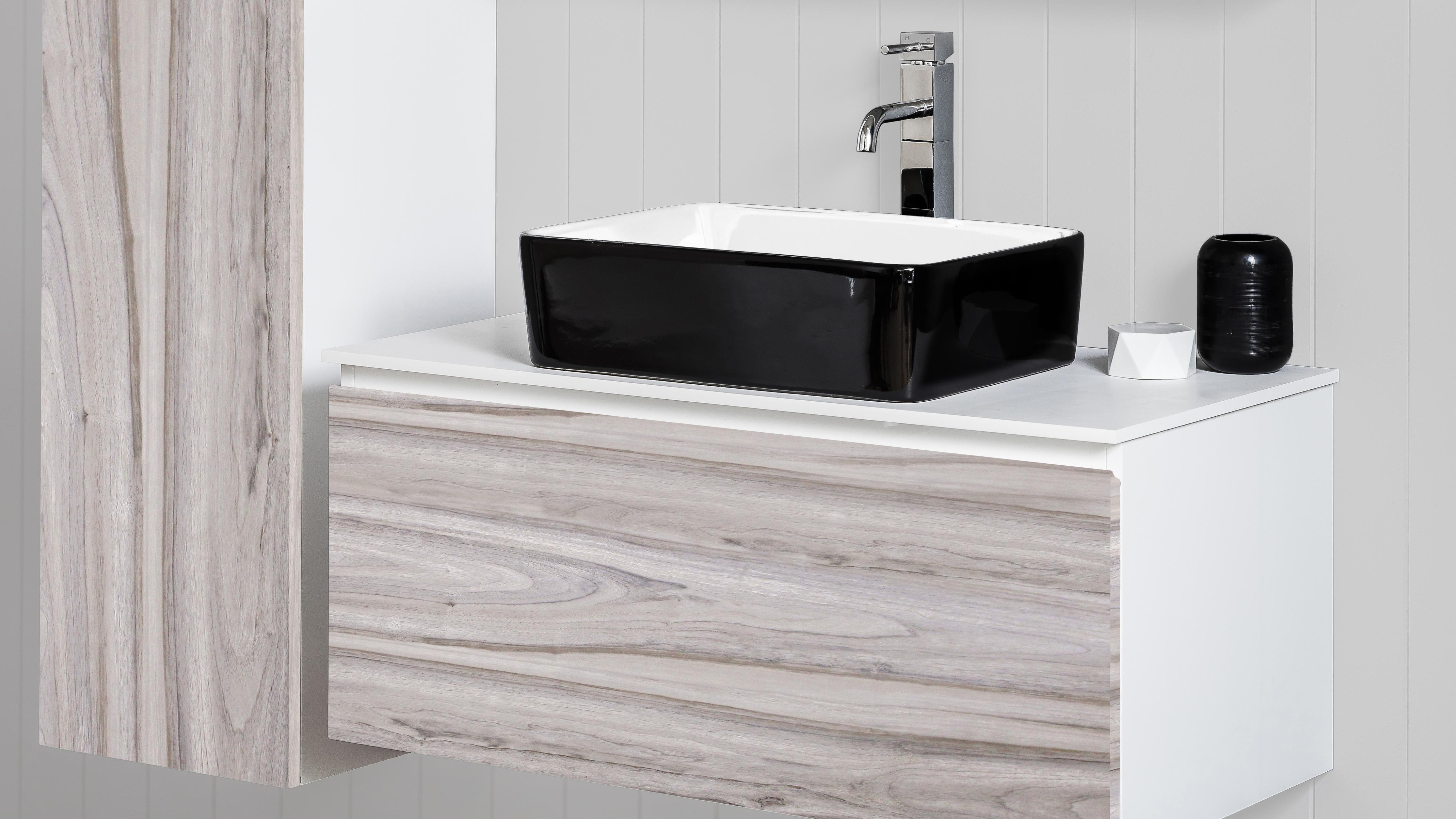 Bathroom with wall-hung cabinet and floating vanity both in oak style.