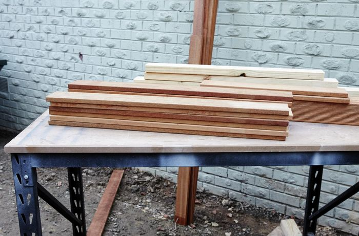 Timber laid out on a tabletop.