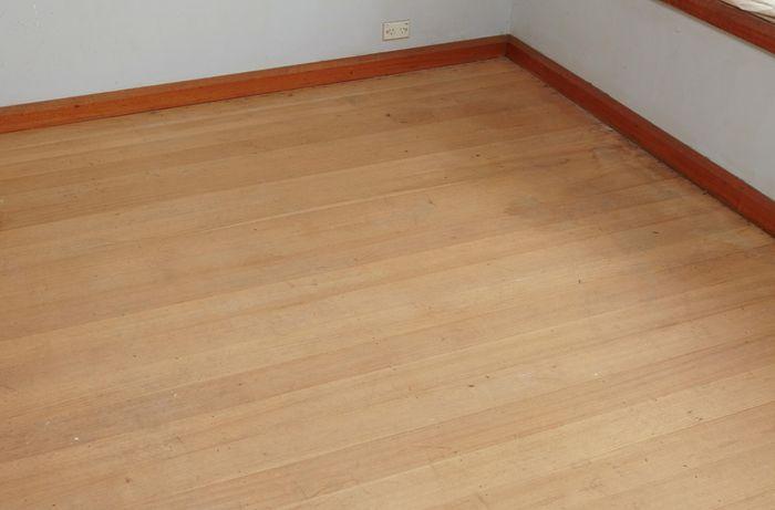A hardwood floor before being sanded