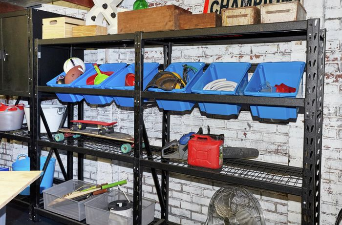Garage shelves with assorted items on them.