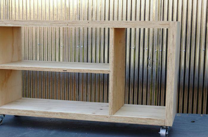 An open timber shelving unit on castor wheels