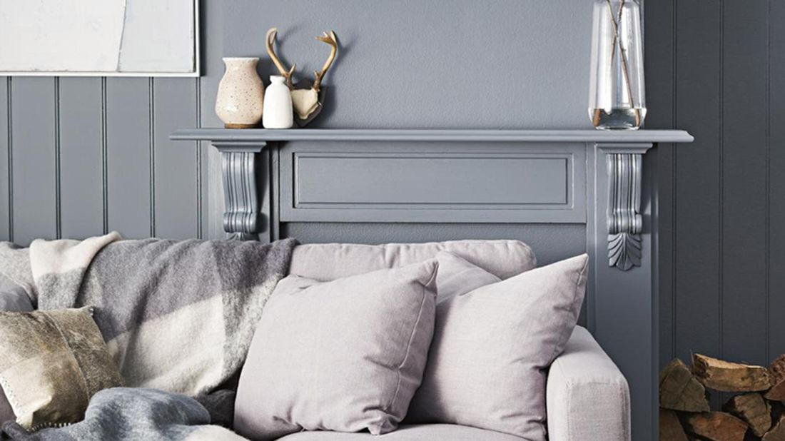 Couch with grey colour palette walls behind.