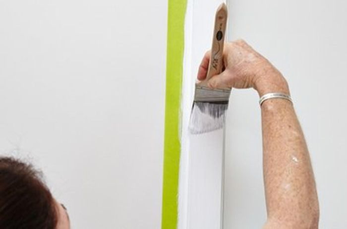 Person painting trims.