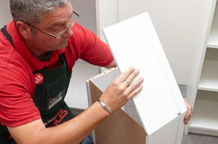A Bunnings team member assembling a drawer.