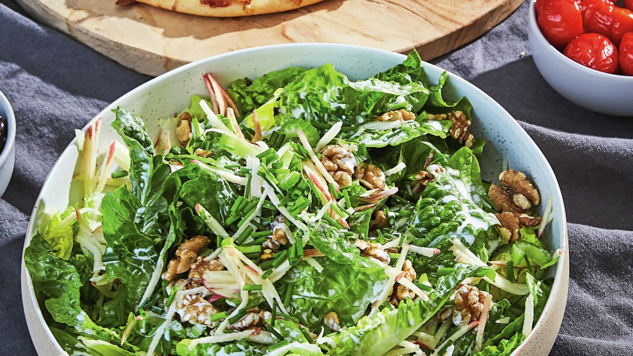 Cos and walnut salad in a serving bowl