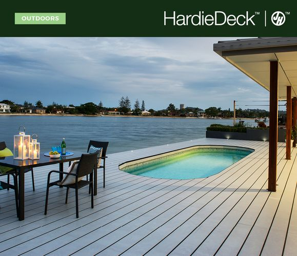 Outdoor timber decking area by pool next to river