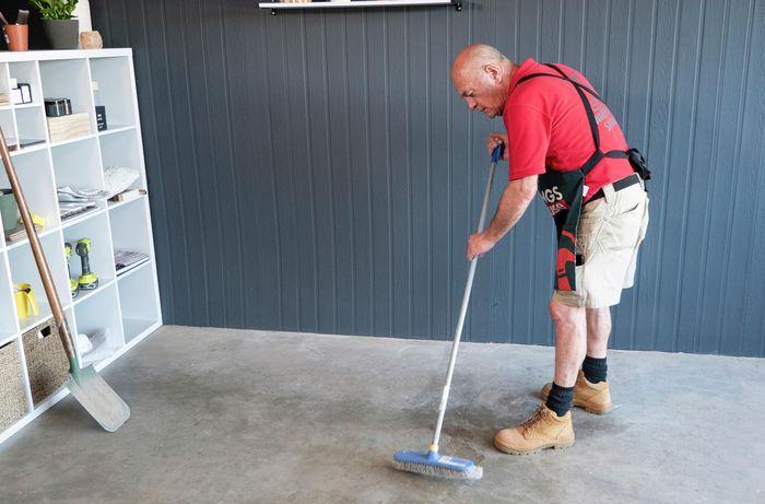 Bunnings team member sweeping garage floor