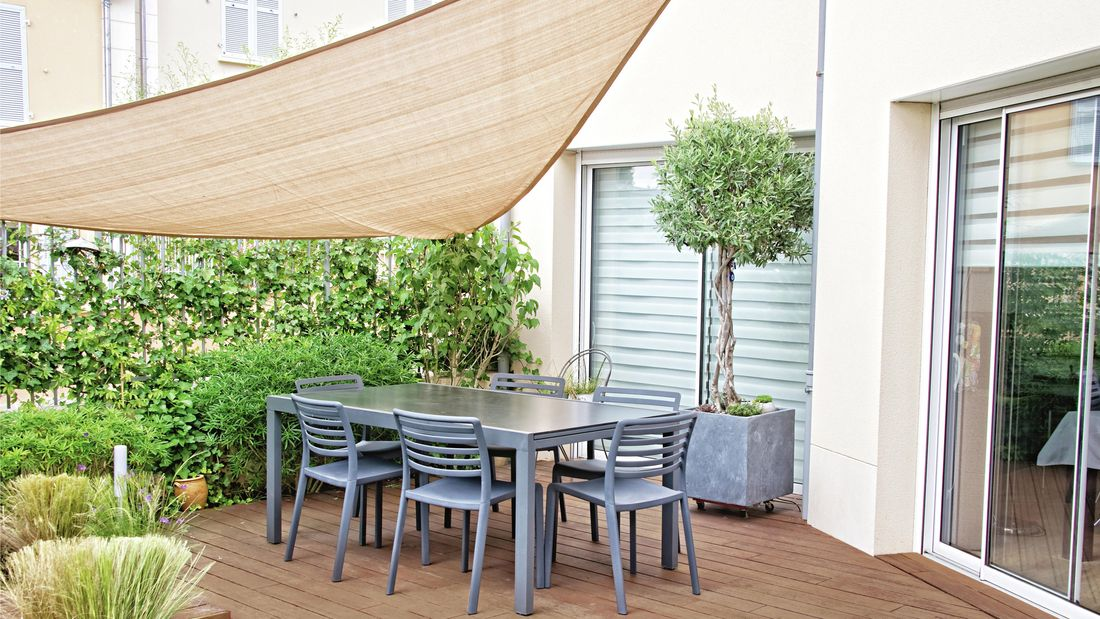 Shade sail over a table on an outdoor deck