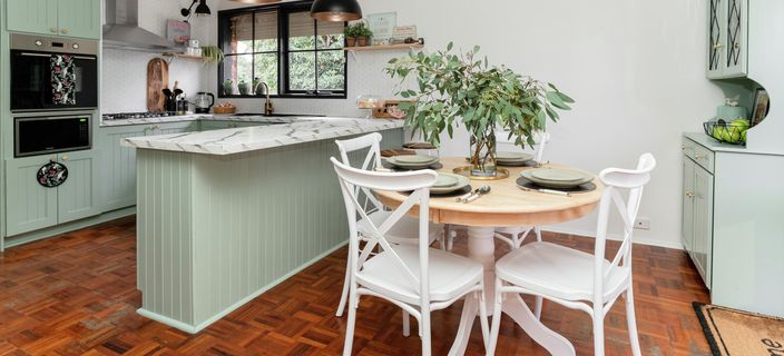 Kitchen with dining table and hutch