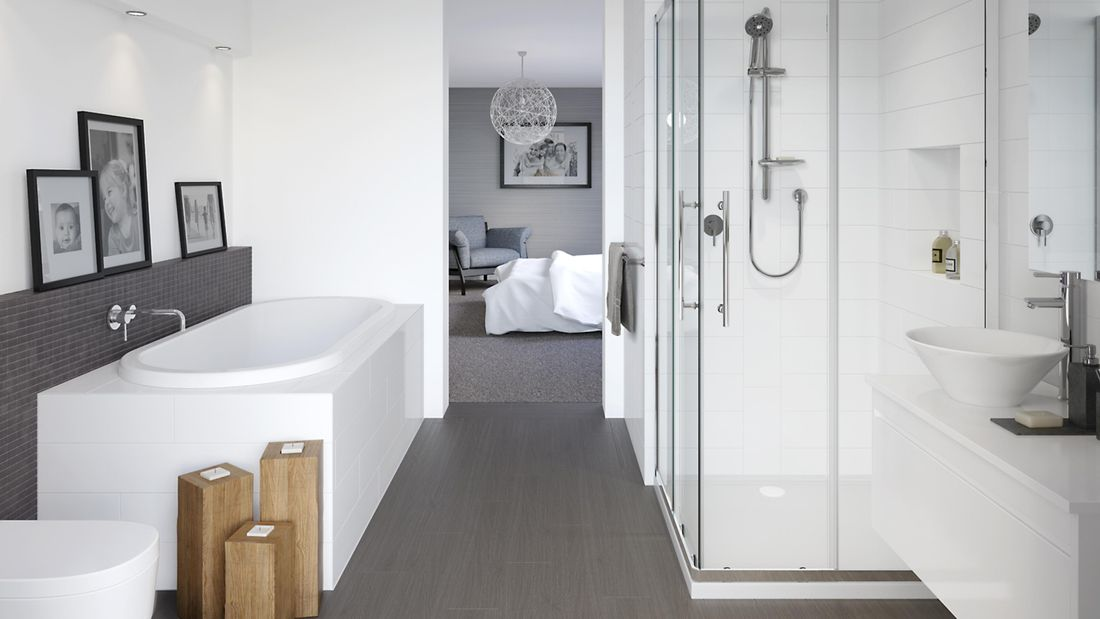 Modern bathroom with a grey and white colour scheme. There is a bath, shower and sink in shot.