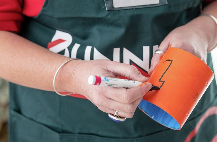 A Bunnings team member decorating part of a tool caddy