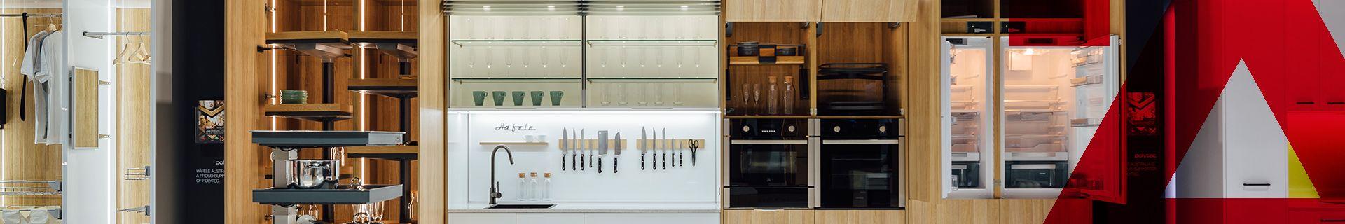 Hafele banner featuring a modern, open plan kitchen.