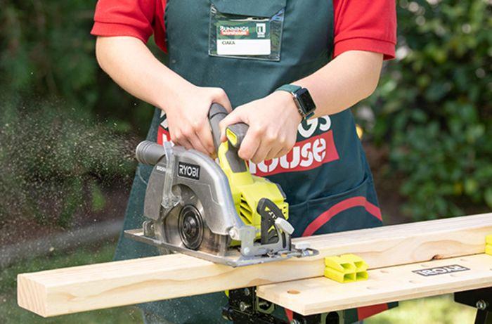 Bunnings team member cutting a piece of timber with a circular saw