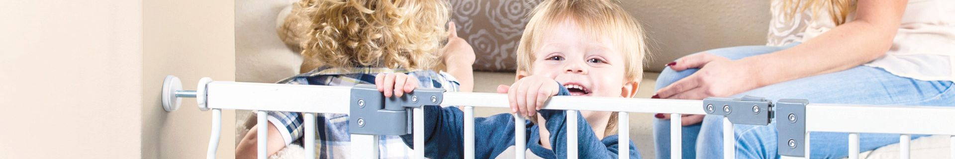 Toddler peaking over child safety gate