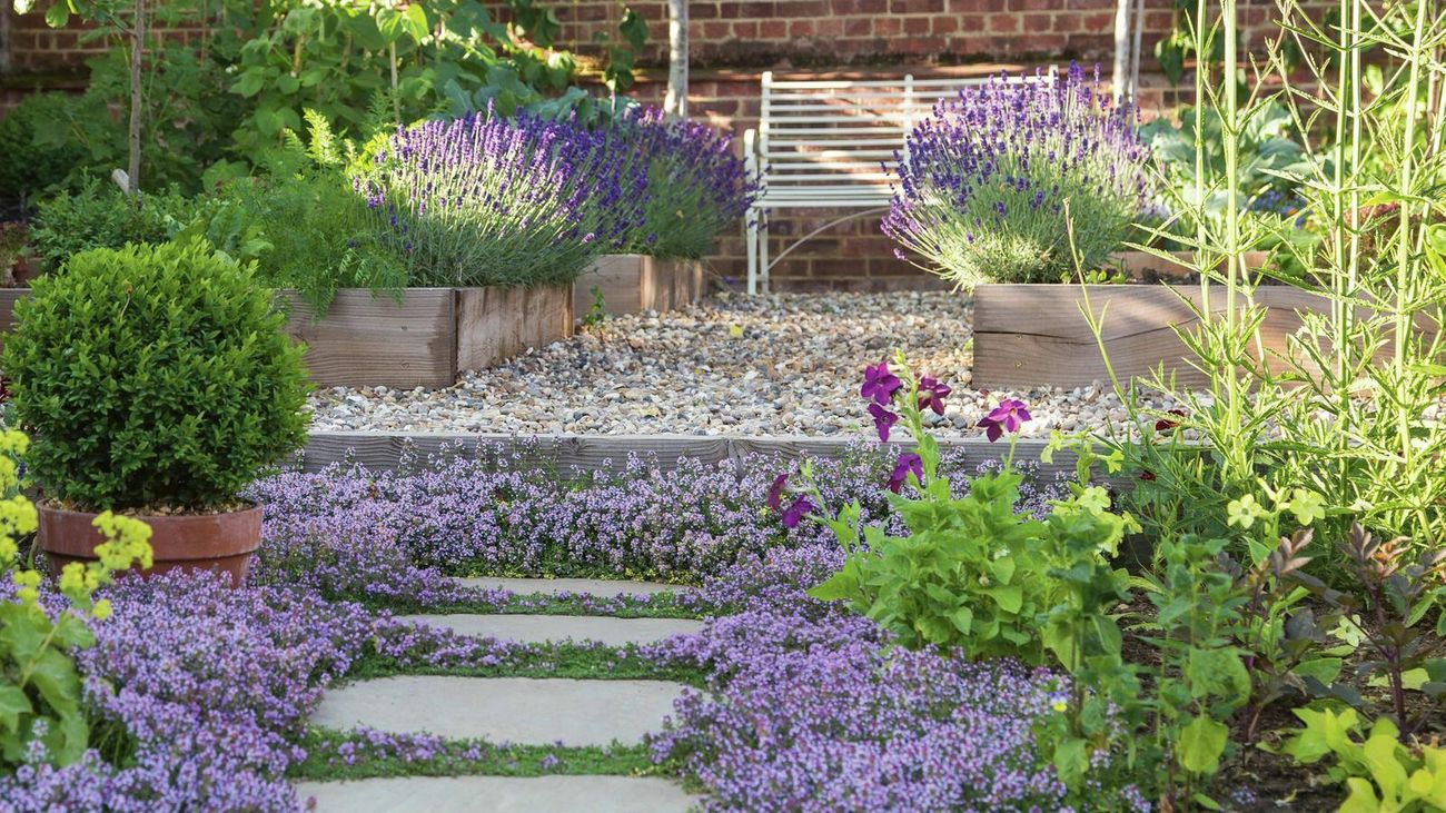 garden bed with pavers and pebbles