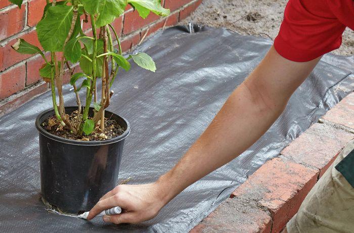 DIY Step Image - How to install weed matting . Blob storage upload.