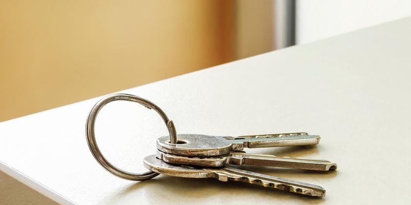 Set of keys sitting on benchtop.