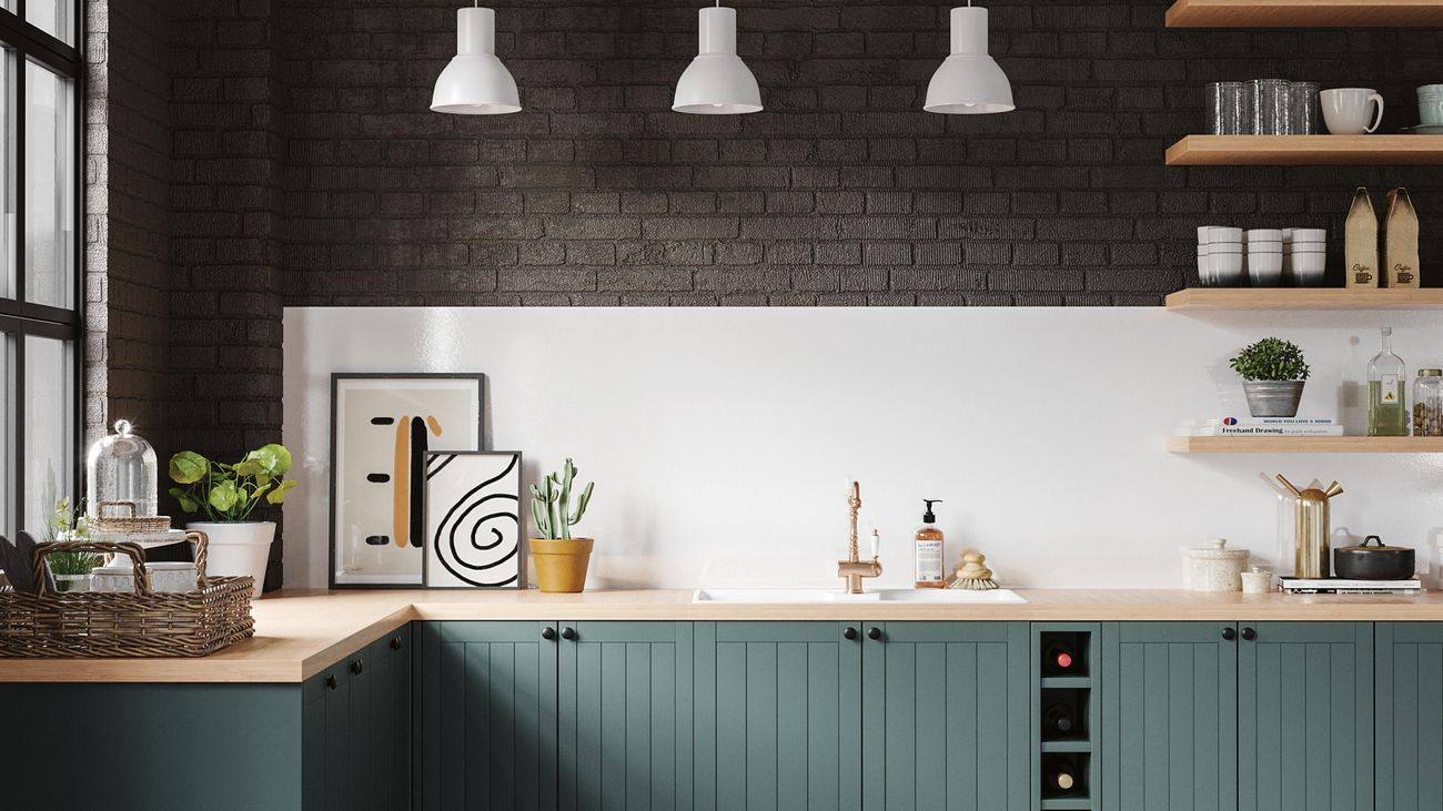 Country, farmhouse style kitchen with rich green cabinets, brass tapware, and matte black accessories]