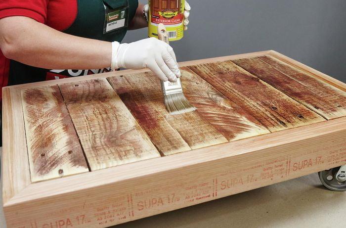 The surface of a pallet coffee table being varnished
