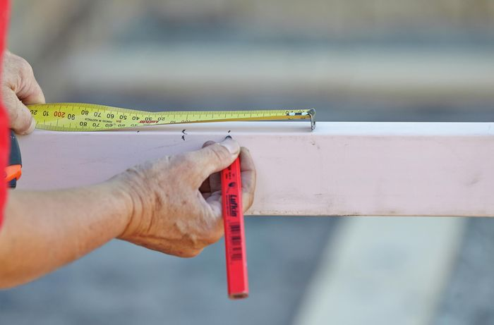 DIY Step Image - How to install pickets for a picket fence . Blob storage upload.