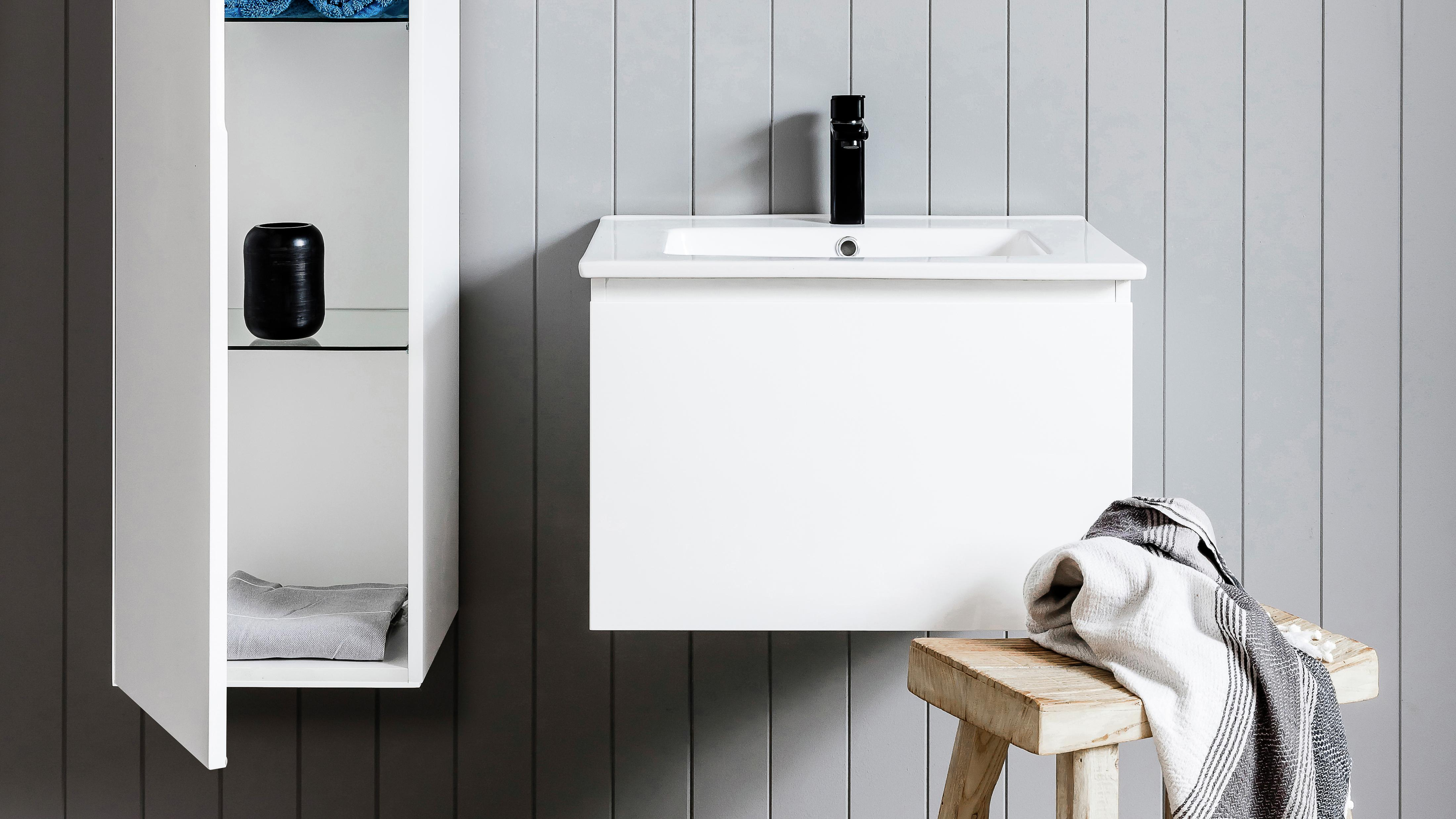 Bathroom with wall-attached cabinet and floating vanity.