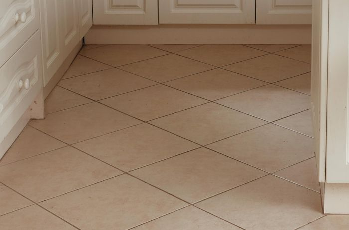 Dated tiles in peach shade.