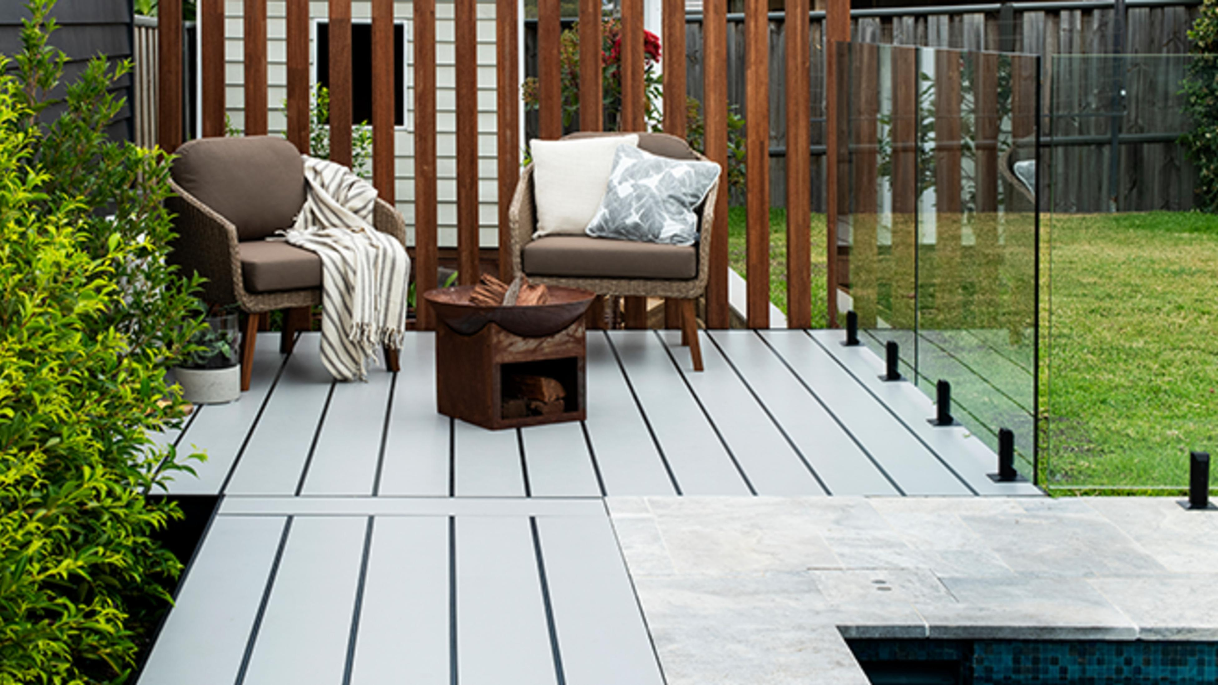 Outdoor deck area with furniture and plants