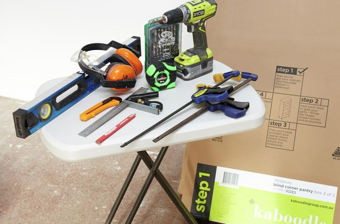 Tools and materials required for project including clamps, drill, tape measure and level